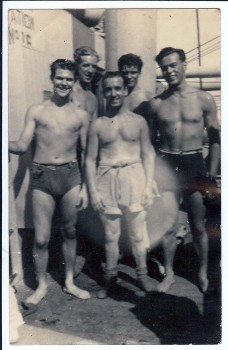 Alf Lennon (center) and shipmates at sea.