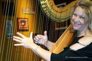 Lori Andrews and her harp on the set of House Blend