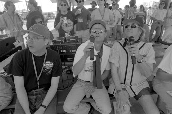 Joe Nick Patoski and Doug Sahm heckle the players during the 1999 SXSW softball game.