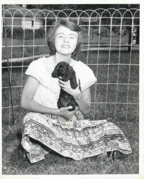 Joan Ruth Sullivan, age 17, and Pepper, her cocker spaniel, Neenah, Wisconsin, 1946.