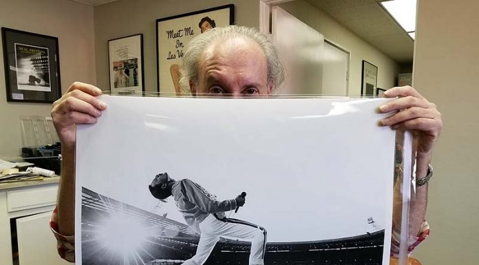 Neal Preston with photo he took of Freddie Mercury in London in 1986. Photo: Stephen K. Peeples.