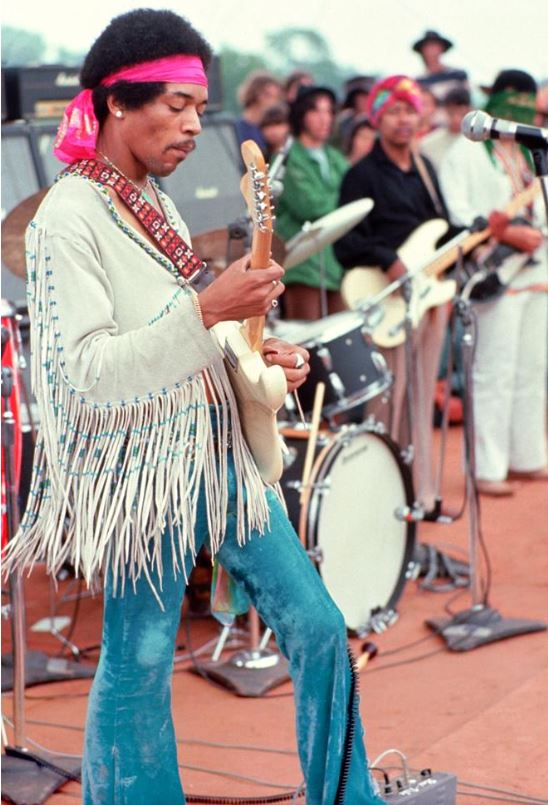 Jimi Hendrix and members of backing band The Electric Church onstage the morning of Monday, Aug. 18, 1969. Photo: Henry Diltz. Used with permission.